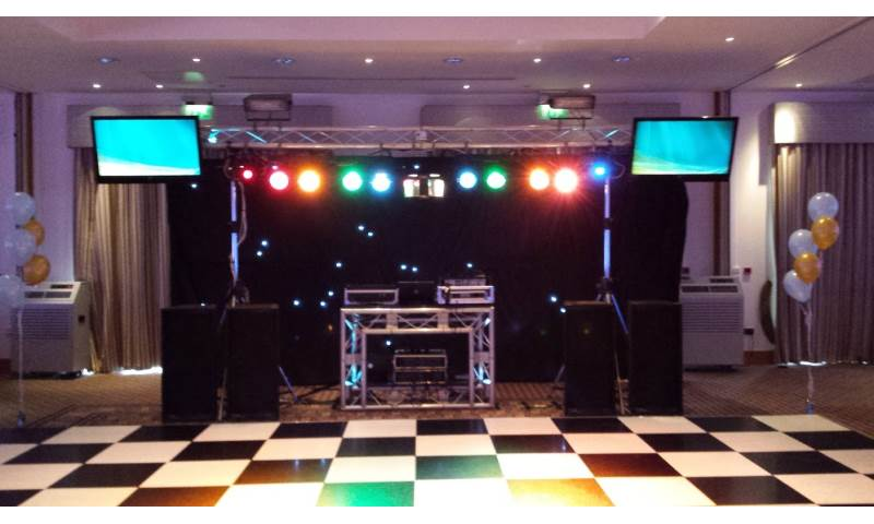 Black Platinum Disco Rig with large centrepiece, TVs and hi-tech DJ booth.jpg