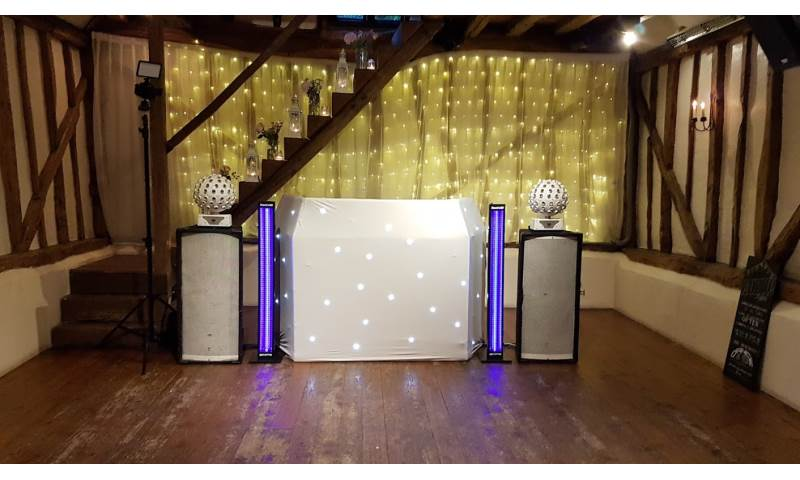 Mini-Hi-Tech Rig with white Starcloth DJ booth and UV tubes.jpg