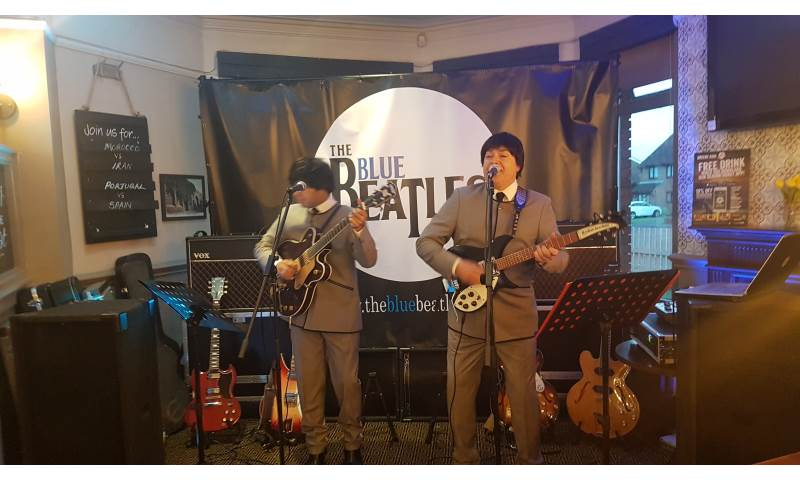 The Blue Beatles Duo performing in grey collarless suits.jpg