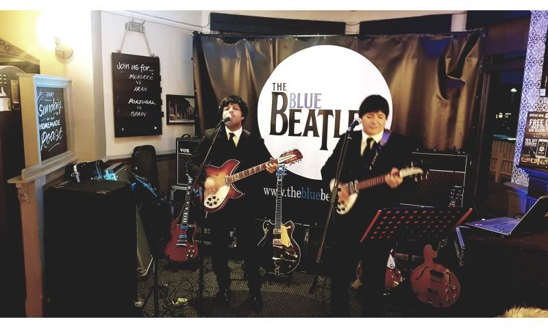 The Blue Beatles Duo performing in black Chesterfield suits.jpg