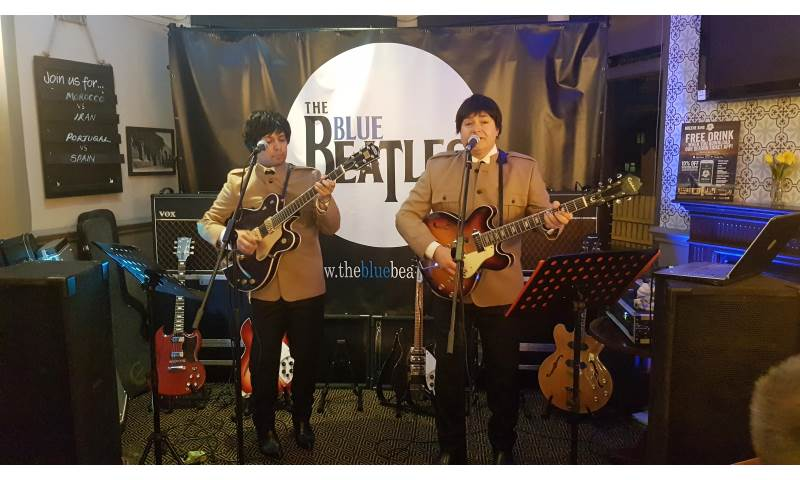 The Blue Beatles Duo performing in Nehru jackets suits.jpg