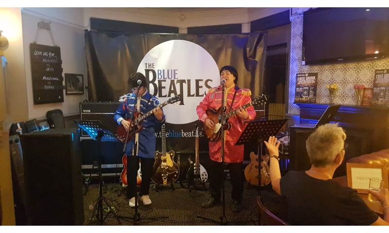 The Blue Beatles Duo performing in Sgt Pepper uniforms.jpg