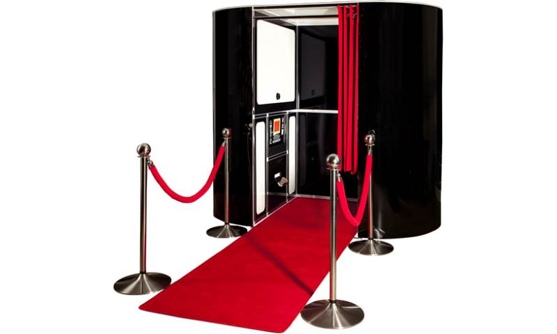 black photobooth with red carpet.png