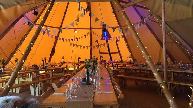 Giant Tipi - table:bench sets seating arrangment .jpg