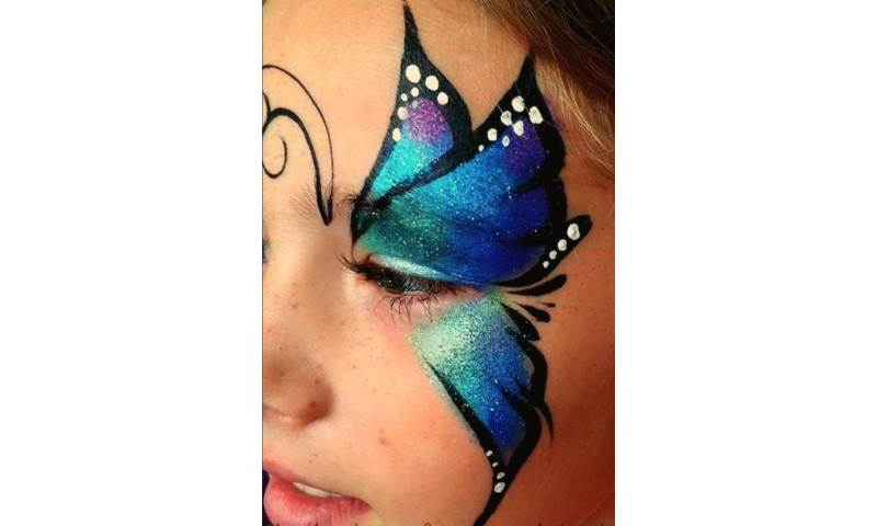 Face painting single eye butterfly.jpg