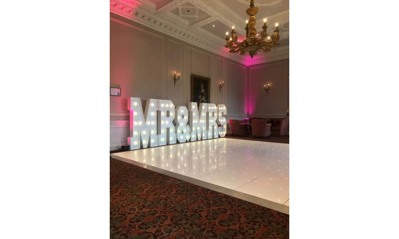 The stunning Crathorne Hall Hotel with one of our gloss white Led Starlit dance floors and our giant Led Mr & Mrs with blush pink uplighting.