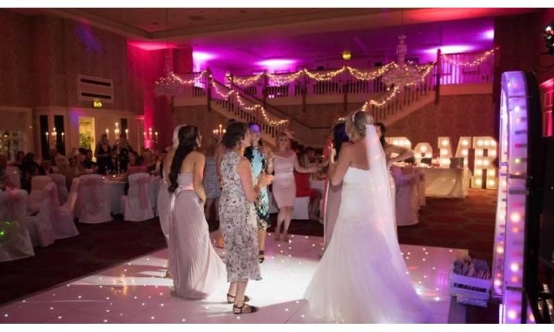 Twilight package @ Gisborough Hall, Starlit white Led dance floor, pink & purple uplighting and our giant illuminated Mr & Mrs.