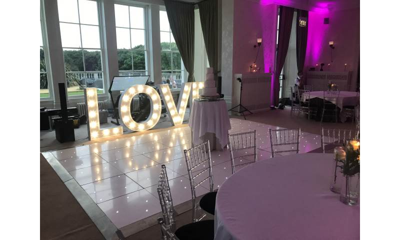 One of our white Starlit Led dance floors and purple uplighting at the spectacular Seaham Hall.
