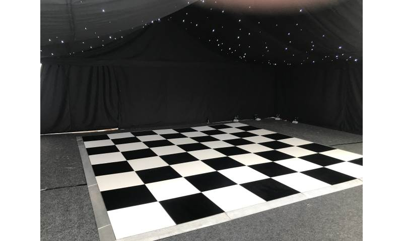 Waiting to get the party started for this wedding in Darlington with one of our Black & White dance floors in a stunning Marquee setting.