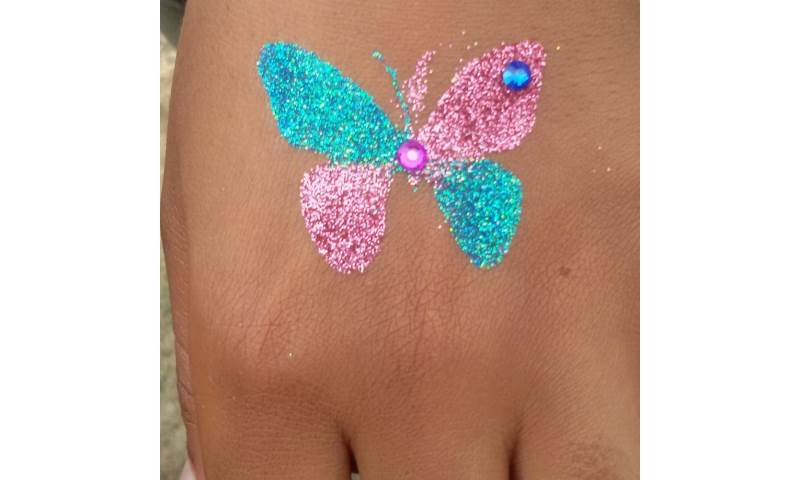 Butterfly glitter tattoo with gems