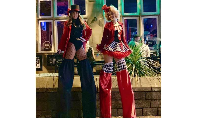 Ringmaster and Clown stilt walking duo - Greatest Showman