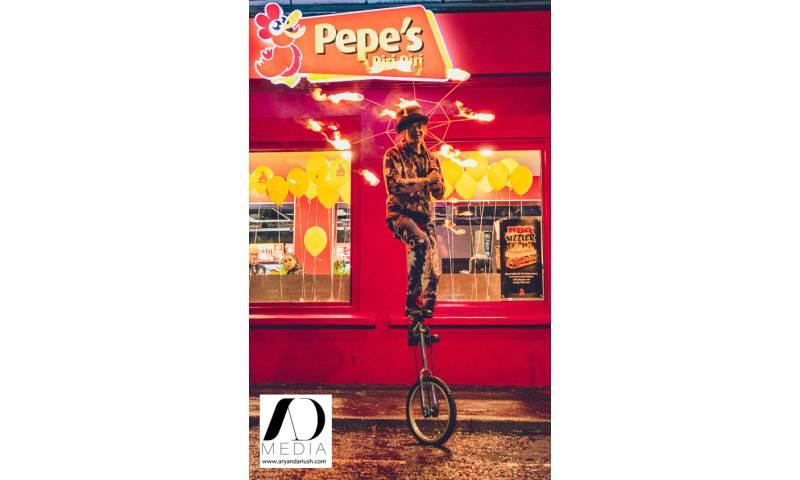 Fire-Umbrella-Unicyclist--at-Pepes-Piri-Piri-Paisley.jpg