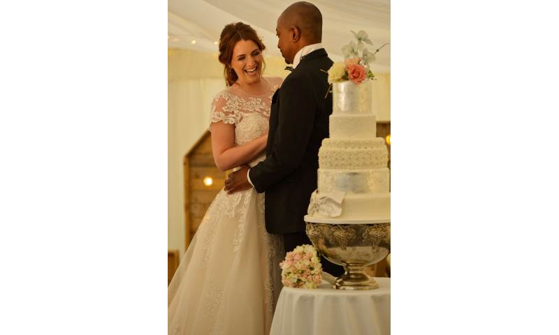 Bride and groom with their wedding cake