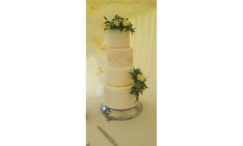 Elegant 4 tier wedding cake by a Cambridge cake designer