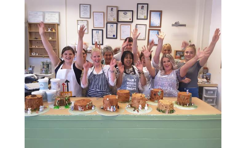 Group of pupils cheering after finishing their chocolate workshop.