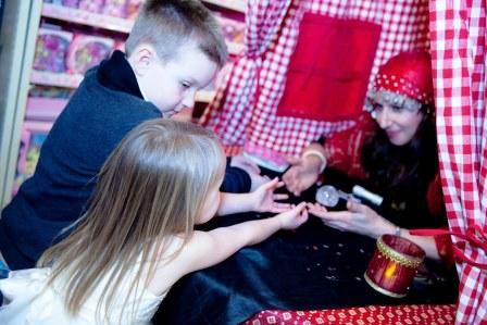 Amelie Appleby reads children's palms at Hamleys