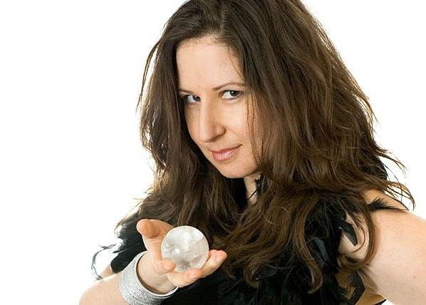 Amelie Appleby mingles amongst guests with her crystal ball
