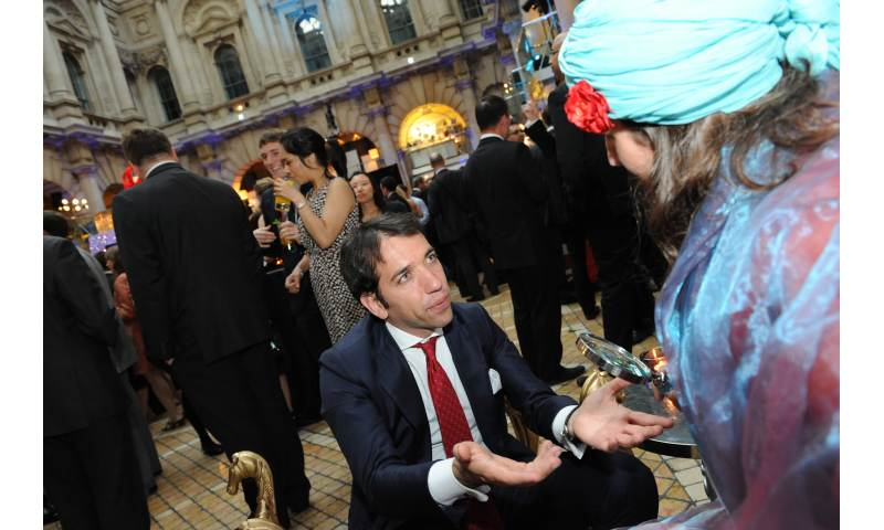 Amelie Appleby entertains with palm readings at Corporate Events
